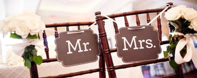 bride and groom chair signs wedding details