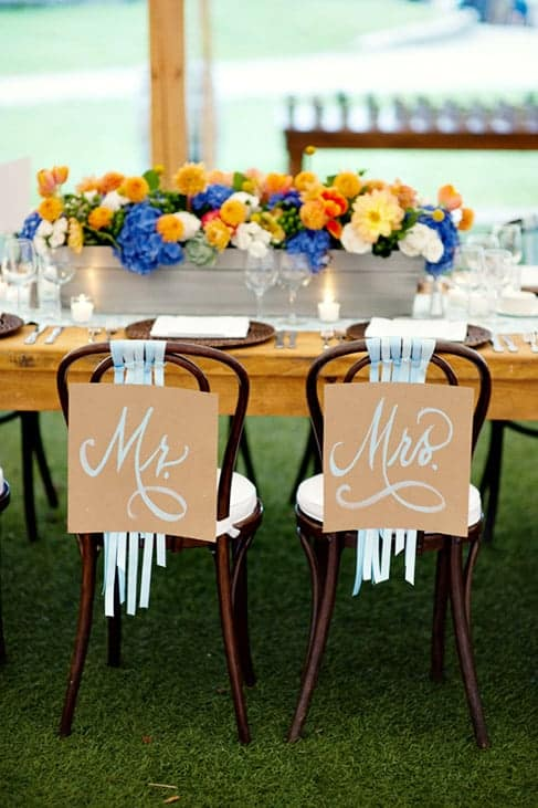Mr. and Mrs chair signs head table wedding details